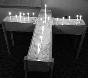 Candles in the corss represent the prayers of the members of St. Stephen Lutheran Church in Cedar Rapids, Iowa following the shooting in Orlando.
